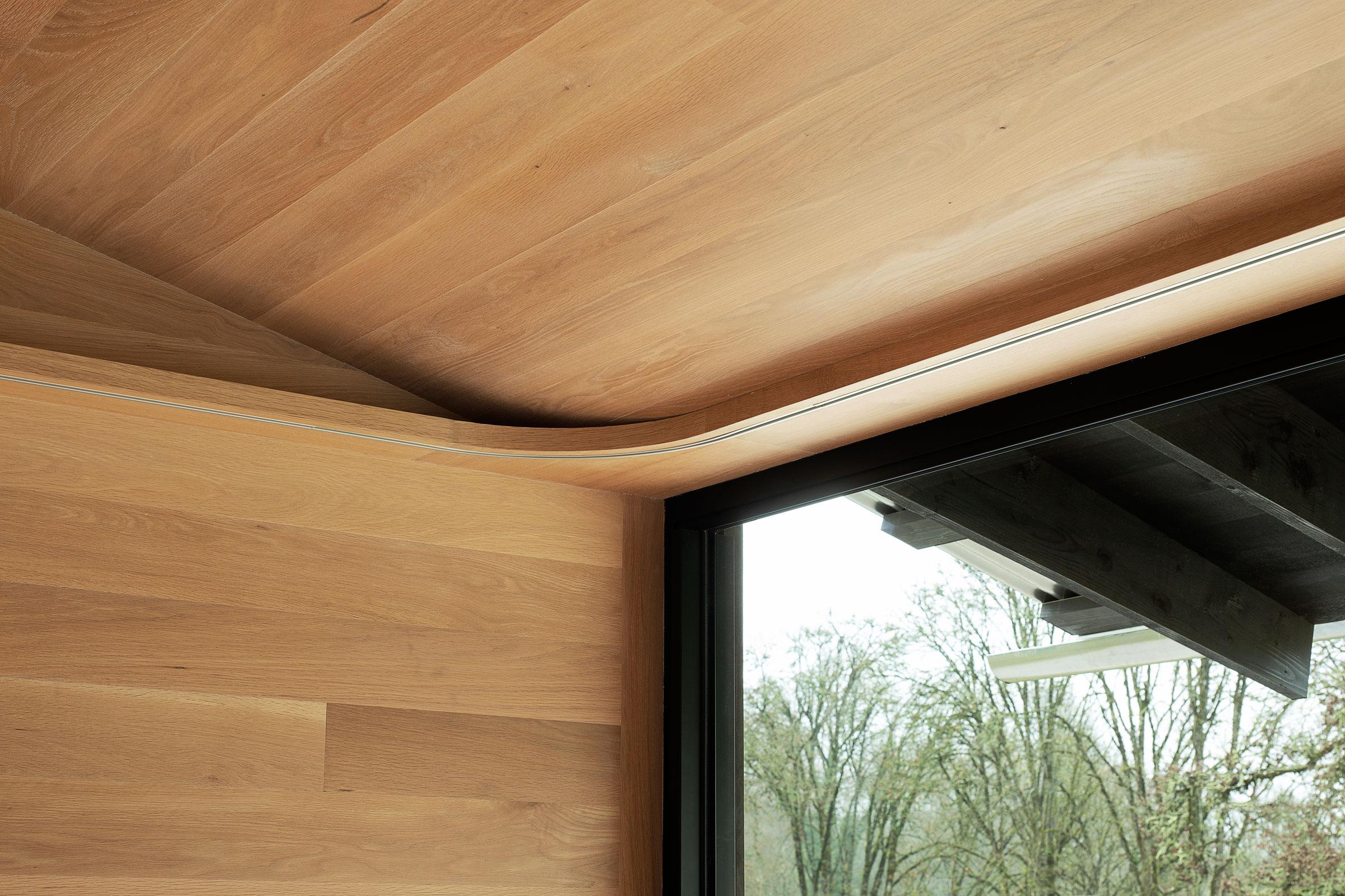 Divine House. Curtain track corner detail