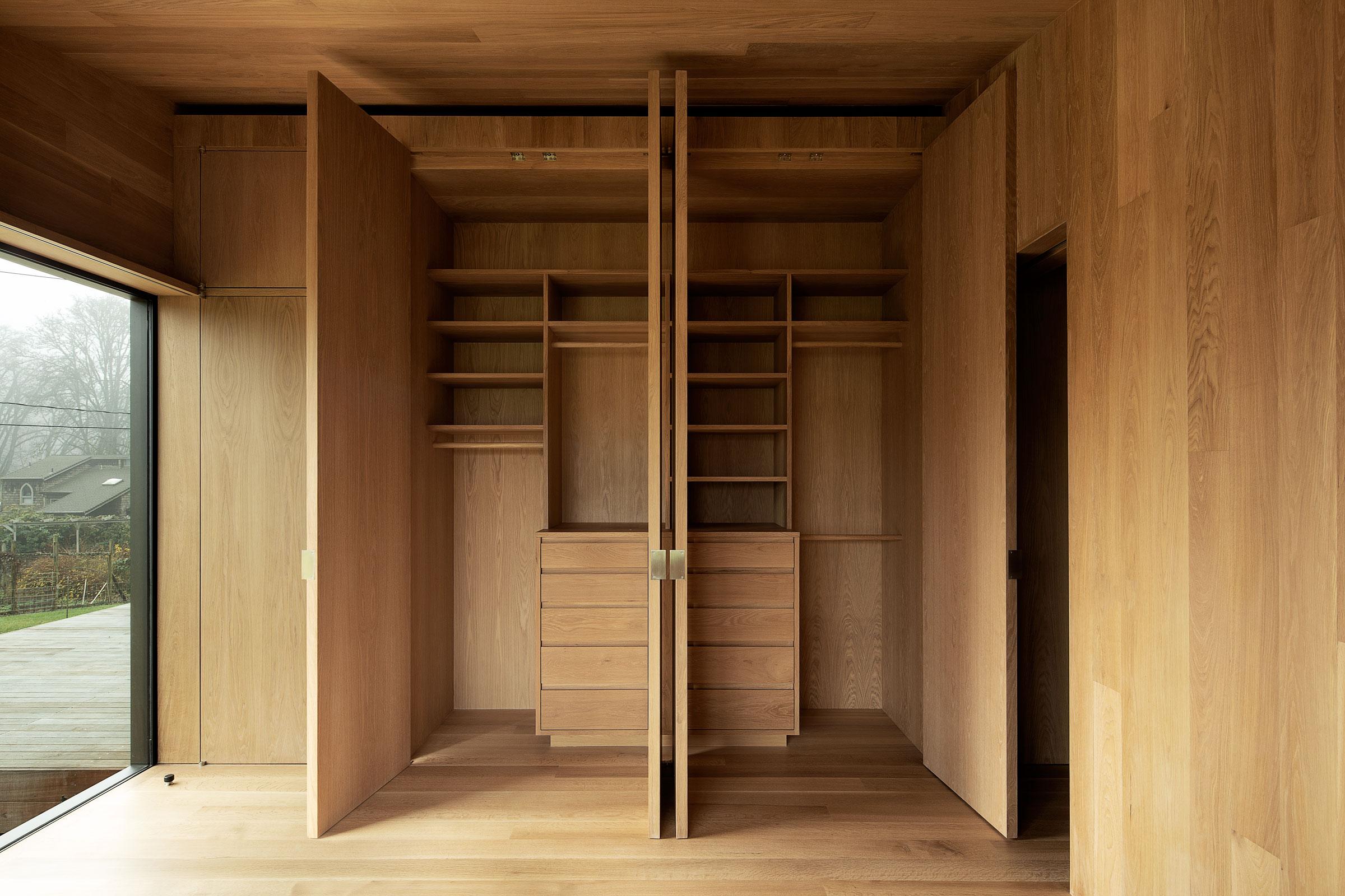 Divine House. Primary bedroom, all closet doors open